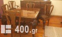 Πωλείται  Σετ Τραπεζαρίας(επεκτείνετε) και σερβάντας(μπουφέ) με 6 καρέκλες και 2 πολυθρόνες ξύλο/δέρμα απο μασιφ χειροποίητη σκαλιστή καρυδιά με λεοντοπόδαρα χρονολογίας 1955